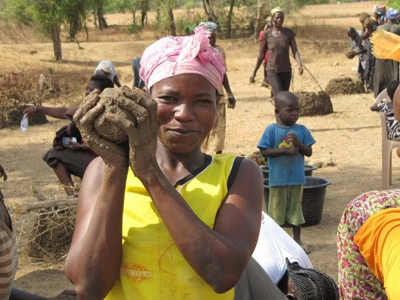 Building mud walls to protect tree seedlings, Bongo, Gh109.JPG