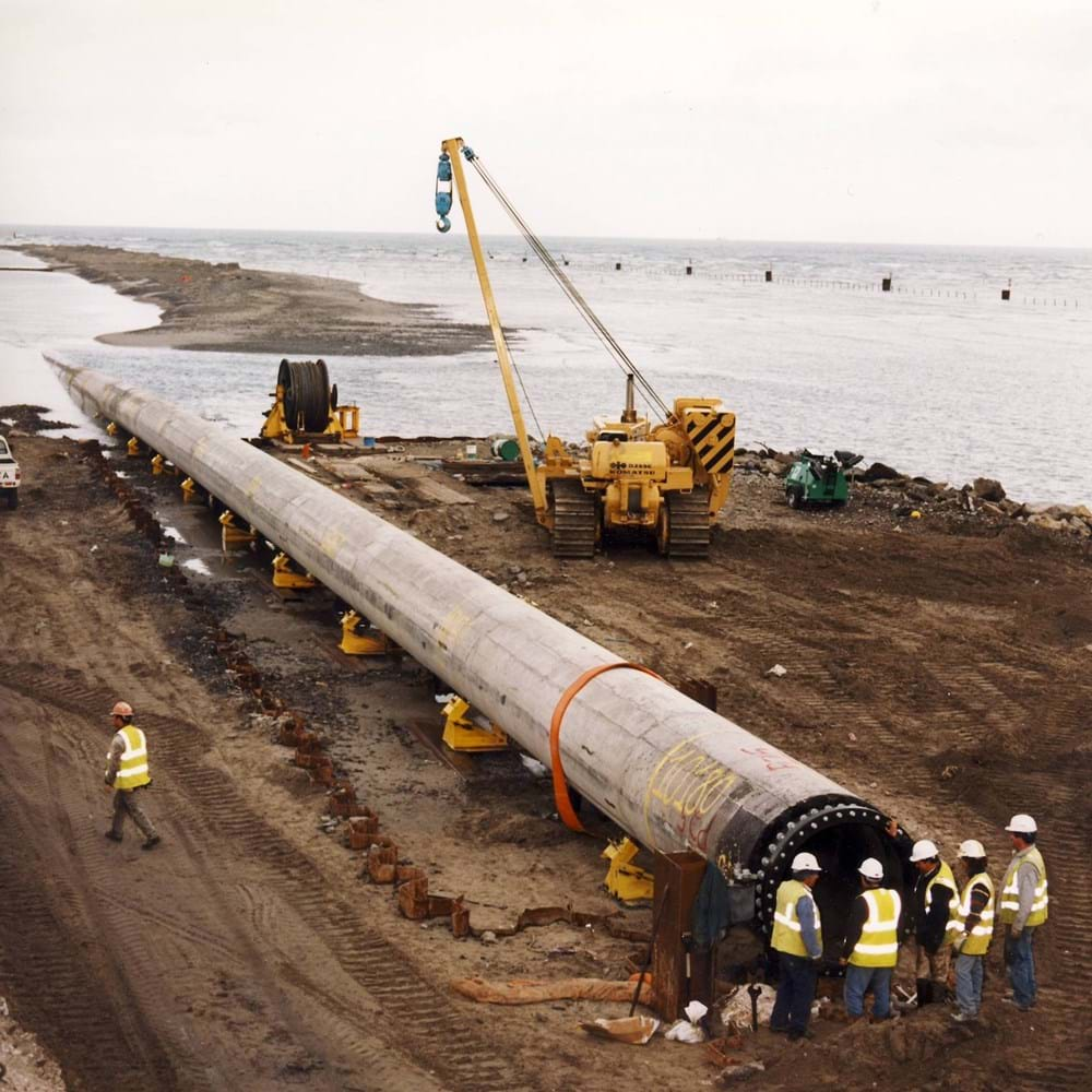 Construction workers supervising installation of 1400mm x 11km submarine pipeline in Dublin Bay.